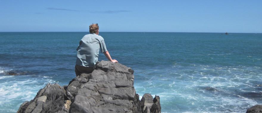 man-rock-ocean